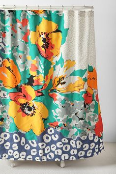 I am loving these colors! Teal, orange, grey and royal blue floral shower curtain from Urban Outfitters