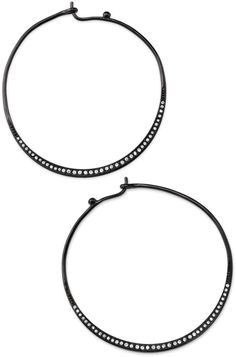 A graduated channel of hand-set glass stones adorns a delicate hoop of shiny hematite plating. Lightweight.  2' diameter.  Tension wire closure.  Shop with me today@ www.stelladot.com/sites/NanciDalton