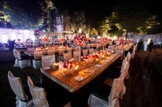 long candle-lit tables