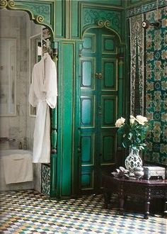 Moroccan bathroom with beautiful tiling and lovely green doors. #MoroccanBathroom.