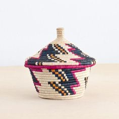 HANDWOVEN IN UGANDA A COLLABORATION WITH ROSE & FITZGERALD This basket is packed with symbolism. In Uganda, legend has it that if you put a token for a inside, that wish will come true. These tokens c