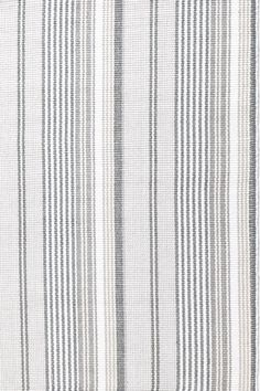 Dash & Albert | Gradation Ticking Woven Cotton Rug | You%27ll never have a grey day with our latest neutral, featuring a variegated stripe in shades ranging from cream to taupe and gunmetal.