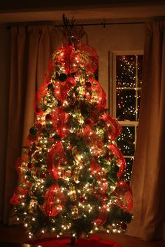christmastreedecoratedwithribbons our tree topper this year