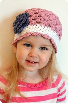 Free Crochet pattern.... cute, cute I'm not sure if I like the hat or that it looks so cute on this little girl.