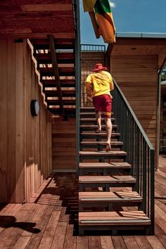 A lifeguard runs up external stairs to the patrol tower. The new clubhouse will help its trained lifesavers to protect swimmers along this stunning coastline.
