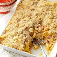 Deluxe Baked Macaroni and Cheese Recipe -I've been cooking and baking for many years, but I've only recently begun creating my own recipes. By adding diced ham, tomatoes, several cheeses and a hint of Dijon mustard, I turned this super creamy mac and cheese into the ultimate comfort food. —Kathy Yarosh, Apopka, Florida