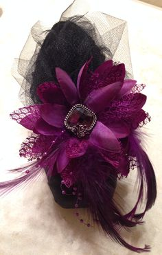 Amethyst Jungle, feathers and crystal accent this shoe. $40.00.