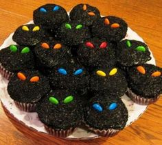 Spooky cupcakes: frost cupcakes then cover with chocolate sprinkles, use M candies for the eyes.