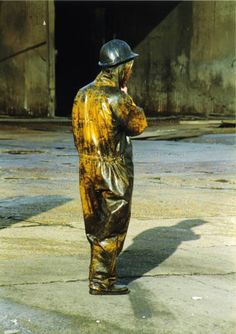 Power washers wearing dirty yellow protective PVC coveralls. Power washers wearing yellow protective PVC coveralls 2