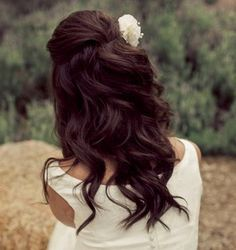 curly half up half down with flower
