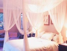 Gauzy bed canopy - I have a ceiling fan so this will work better in our bedroom. shopwildthings.com
