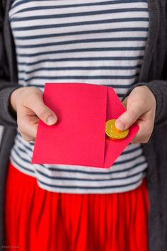hongbao envelopes are red envelopes filled with money or chocolate coins given to children from elders during Chinese New Year