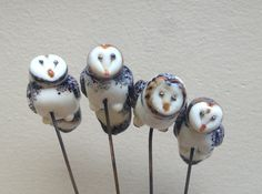 Family of lampwork glass owls by Alexis Berger