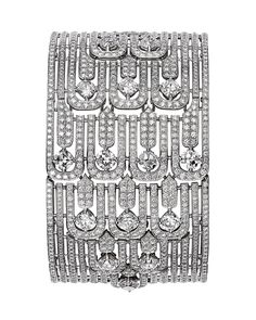 L'Odyssée de Cartier Parcours d'un Style 'The City' high jewelry bracelet in platinum, set with cushion-shaped diamonds and diamonds.