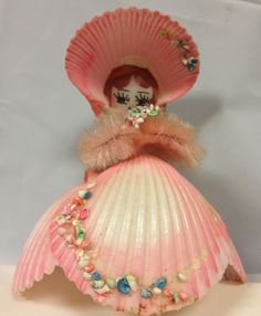 Vintage Sea Shell Girl Figurine Pipe Cleaner Arms Holding Flower Pink Shell Art