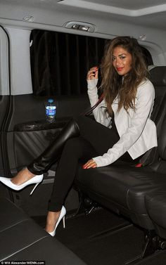 Travelling in style: The singer looks every bit a VIP as she reclines in a luxury car...