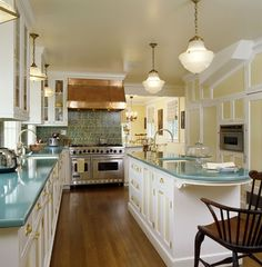 Colorful Kitchen in New York - Traditional white cabinets, copper stove hood, turquoise blue countertops - Felhandler/ Steeneken Architects