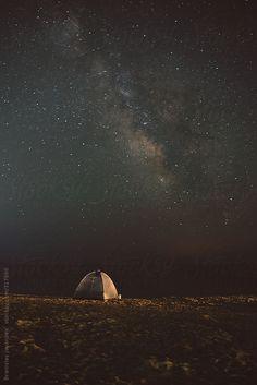 A tent on the beach under the starry sky by BrkatiKrokodil   Stocksy United