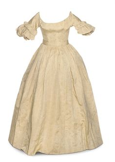 Afternoon Gown: ca. late 1830's, figured silk, with short sleeves trimmed with ruched silk.