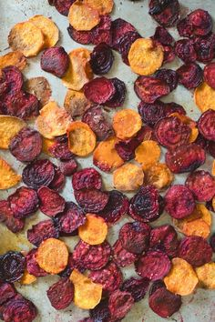 This recipe for homemade beet and sweet potato chips couldn't be simpler and we love the vibrant colors of this healthy snack.