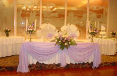 Bride and groom table SETUP ONLY. Cake table in one corner and gift table? in the other.