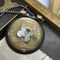 Antique Hebdomas 8 Day Pocket Watch Mainspring Cover Necklace with Butterfly Charm by The Victorian Magpie