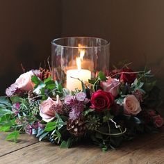 A beautiful combination of scented red and antique rose heads arranged with astrantia, skimmia, rich berries, pine cones and finished with ivy trails, herbs and seasonal foliage.The Real Flower Company Red & Antique Luxury Table Christmas WreathIs t Candle Arrangements, Floral Centerpieces, Table Centerpieces, Wedding Centerpieces, Wedding Table, Floral Arrangements, Wedding Decorations, Christmas Arrangements, Centrepieces