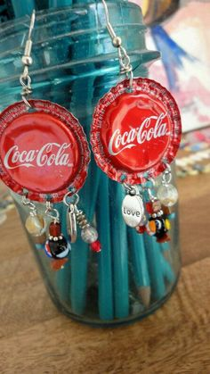 Recycled Coca-Cola Bottle Cap Earrings via Scrap Therapy (Etsy.) Handmade jewelry from South Carolina. Bottle Cap Earrings, Bottle Cap Jewelry, Bottle Cap Art, Diy Earrings, Bottle Top Crafts, Bottle Cap Projects, Diy Bottle, Coca Cola, Beer Caps