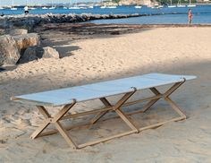 Folding daybed. Inspired by traditional folding marine furniture. The plastic language is strongly defined by the characteristic construction of the folding structures and the special way of achieving a folding hinge.