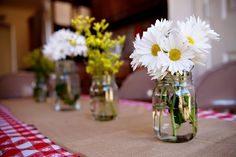 Like the red and white with burlap over.  White daisies - simple, pretty and easy.
