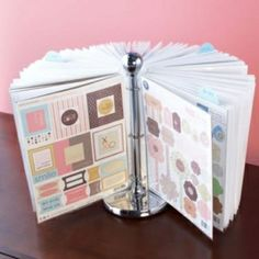 paper towel holder with page protectors attached by binder rings... great for organizing/displaying all kinds of stuff!