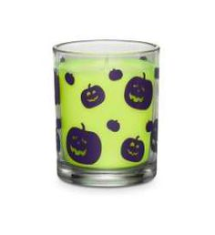 """Hocus Pocus™ Halloween Novelty Jar.  Favorite fall fragrance is presented in a fun, pumpkin-print glass jar. Highly fragranced Hocus Pocus™ wax fills the air with the scent of coconuts and pralines. Burn time: 30-40 hours. 3 1/4"""" h, 2 3/4"""" dia. Jar is safe for food use after candle has consumed."""