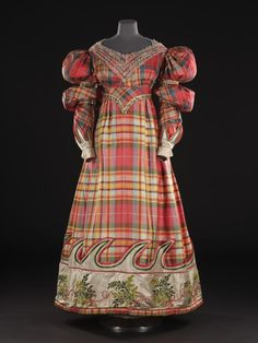 Woman's high-waisted dress of silk, with a lace-trimmed bodice and a band of white satin on the skirt, supposed to have been worn by Mrs Macpherson of Cluny: Scottish, 1832.