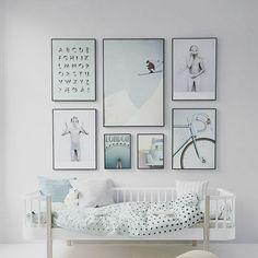 We adore this nursery gallery wall #bornlucky #nurserydesign #designfromdayone #nursery #kids #kidsdesign #art #graphic #print #decor #imagination #blue #alphabet #bike #london #mountain #adventure Image from oliverfurniture.dk.