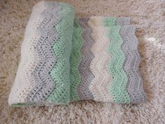Do you know anyone who is expecting?? This mint gray and Ivory baby blanket…