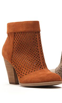 Suede ankle booties with perforated detail, rounded toe and stacked heel.