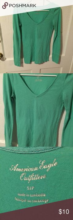 American Eagle Long Sleeve Green Tee Small American eagle long sleeve green tee by American Eagle size small. No defects. If you're worried about fit, feel free to ask for measurements but please don't leave me neutral / negative feedback because the item doesn't fit! =) American Eagle Outfitters Tops Tees - Long Sleeve