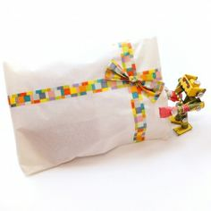 Tutorial on how to make a lovely washi tape bow for decorating your gifts and handmade cards.