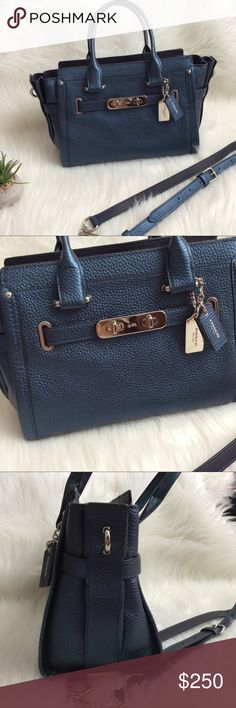 """Authentic COACH SWAGGER 27 Carryall Tote Purse 100% Authentic COACH 36497 SWAGGER CARRYALL Metallic Blue Leather Satchel Shoulder Bag     MSRP: $450.00 + tax  10.5"""" L x  8"""" H x 5"""" W Dual handle straps with  4.5"""" drop Long adjustable strap  17"""" to 20.5"""" drop (detachable)     Exterior: genuine metallic blue pebble leather Decorative Belting with double Turlock Hardware Zip Closure Silver toned hardware Two hang tags bottom protective feet   Navy signature lining 1- slip pocket, 1- zip pocket…"""