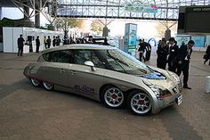 The Eliica (or the Electric Lithium-Ion Car) is a battery electric vehicle prototype or concept car first shown in 2004 and designed by a team at Keio University in Tokyo, led by Professor Hiroshi Shimizu. The 5.1 m (17 ft) car runs on a lithium-ion battery and can accelerate from 0–100 km/h (62 mph) in four seconds (faster than the Porsche 911 Turbo at the time).[1] In 2004, the Eliica reached a speed of 370 km/h (230 mph)