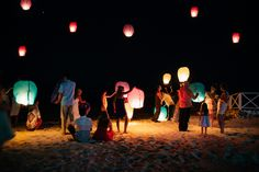 Symbolizing good luck and prosperity, the launching of sky lanterns is a highly anticipated ritual during many wedding ceremonies. Jessica and Chuck  big day inJamaica. Justina Phippen Photography #beachparty #JamaicaWedding
