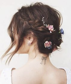 We hear wedding bells chiming off in the distance, no? This romantic, bloom-filled 'do on Lucy Hale by stylist Kristen Ess is all you need for your summer/winter/fall/spring (okay,any...