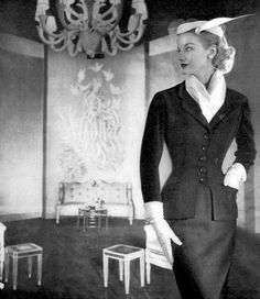 Sunny Harnett in suit by Philip Mangone from I.Magnin, Vogue, August 1, 1951