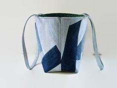 Tote bag, handbag or shoulder bag/purse made out of a variety of upcycled recycled repurposed denim blue jeans and cotton fabric was used to create this unique Crazy Quilt bag. This medium size bag is perfect for carrying all your daily needs, books, magazines or projects. Add a favorite pin to coordinate with your outfit. The front and back exterior denim pieces have been uniquely pieced together Crazy Quilt patchwork style differently which gives each side an original appearance. This...
