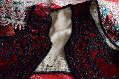 Special occasion waist coat adorned in black beads.
