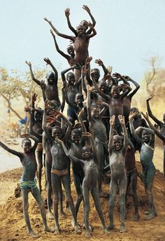Dinka Children on Termite Mound, South Sudan by Carol Beckwith and Angela Fisher