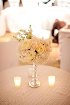 Creamy florals + tealights reception wedding flowers,  wedding decor, wedding flower centerpiece, wedding flower arrangement, add pic source on comment and we will update it. www.myfloweraffair.com can create this beautiful wedding flower look.