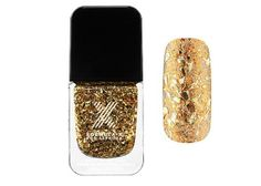 Looks like you've covered your nails in luxe gold leaf.Formula X Sparkly Nail Polish: Lucky Magazine