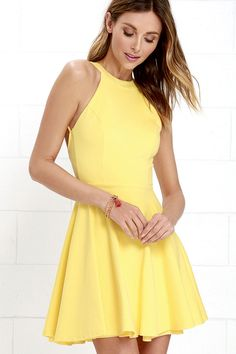 Puppies and perfumes make perfectly fine gifts, but they can't top the Delightful Surprise Yellow Skater Dress! Medium-weight stretch knit shapes a seamed bodice with a halter neckline that fastens at back with a small gold button. Strappy accents frame a sultry open back, while a flaring skater skirt falls below. Hidden back zipper.