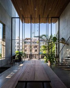 "The Thong House in Vietnam by Nishizawa Architects architecture studio - Journal du Design - With open interior spaces and huge windows that communicate with the outside, this house called ""Th - Exterior Design, Interior And Exterior, Room Interior, Interior Windows, Kitchen Interior, Architecture Design, Residential Architecture, Amazing Architecture, Biophilic Architecture"